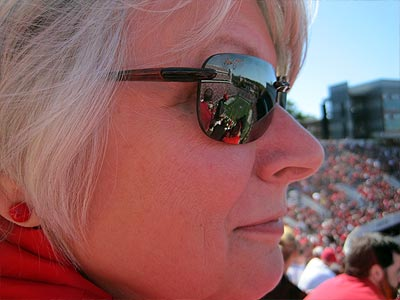 Mom watches the dogs (the actual dogs, not the football team).